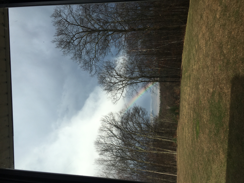 Rainbow and grey clouds